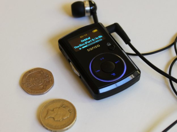 A size comparison between an MP3 player and a coin