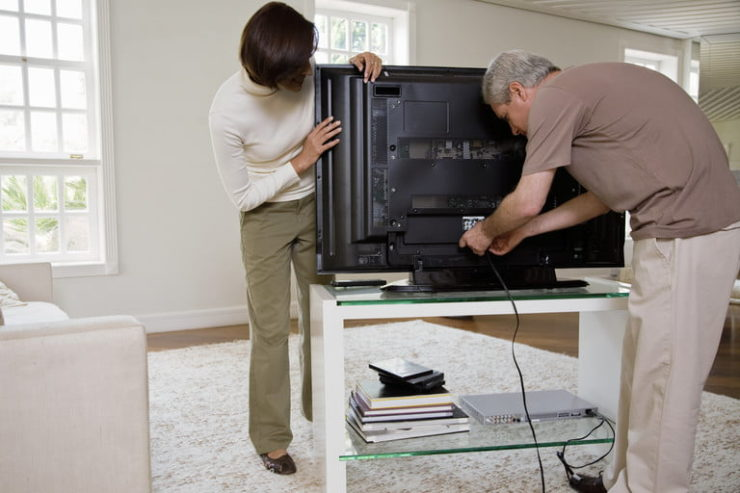 Couple connecting a TV