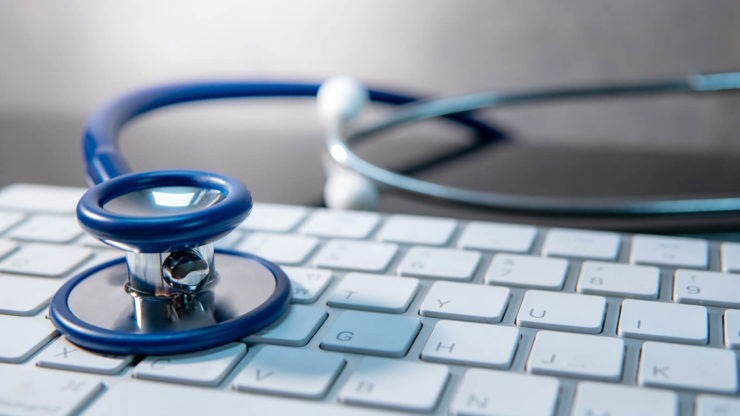 Stethoscope on a keyboard for a health check | Bang IT Solutions